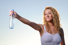Beauty blonde woman with bottle of water Stock Photos