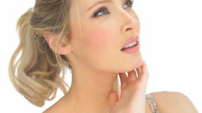 Beauty blonde woman touching her face. Beauty blonde woman touching her fresh face showing her skin stock footage