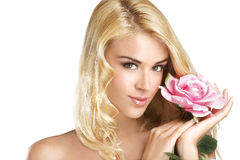 Beauty blonde young woman showing a fresh flower on white Stock Image