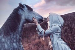 Beauty blondie with horse in the field,  effect Royalty Free Stock Images