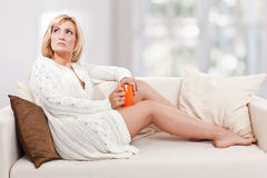 Beauty, blondie woman in a sofa Royalty Free Stock Photography