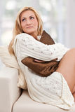 Beauty, blondie woman in a sofa with a pillow Stock Images