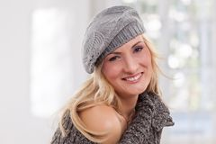 Beauty, blondie woman wear a grey-colored hat Royalty Free Stock Images