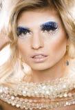 Beauty blong woman ith make up, winter tinsel Stock Image