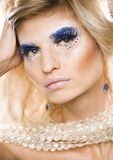 Beauty blong woman with shiny creative makeup Stock Image