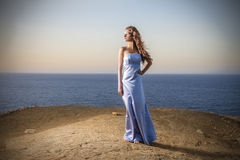 Beauty in blue. A beautiful girl is wearing a light blue dress Royalty Free Stock Photography
