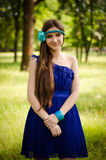 Beauty in blue dress Stock Image