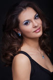 Beauty with blue earrings Royalty Free Stock Photo