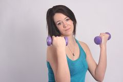 Beauty in Blue Singlet with Dumbbell Stock Images