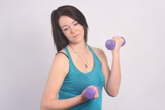 Beauty in Blue Singlet with Dumbbells Stock Photography