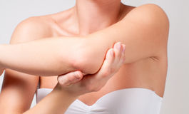 Beauty and Body care. Female elbow. Pain and health care concept Royalty Free Stock Photos