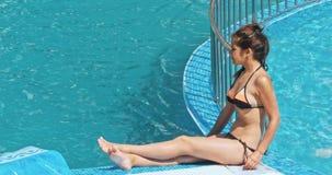 Sensual young woman relaxing near swimming pool. stock video