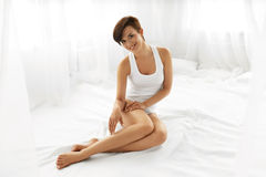 Beauty Body Woman. Beautiful Girl Touching Epilated Long Legs Royalty Free Stock Images