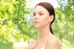 Beautiful woman with moisturizing cream royalty free stock photos