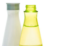Beauty bottles closeup (yellow and white) Royalty Free Stock Photos