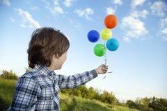 Beauty boy with balloon Stock Photo