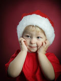 Beauty boy in christmas hat Royalty Free Stock Photos