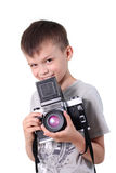 Beauty boy photographer. The little boy holds an big old camera Stock Photography