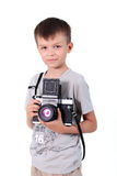 Beauty boy photographer. The little boy holds an big old camera Stock Photos