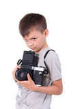 Beauty boy photographer. The little boy holds an big old camera Stock Image