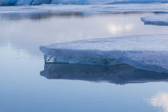 Beauty of breaking Ice in Jokulsarlon with water reflection Royalty Free Stock Photos
