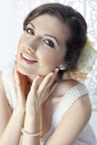 Beauty bride. Portrait of beauty bride in elegant white dress with purls Royalty Free Stock Photos
