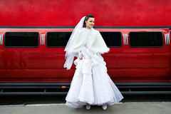 Beauty bride on background red limo car Stock Photo