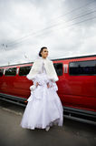 Beauty bride on background red limo car. In wedding day Royalty Free Stock Photos