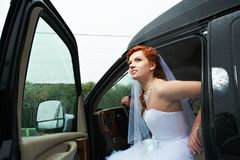 Beauty bride into big car Royalty Free Stock Photography