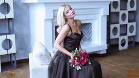 Beauty bride in bridal gown with bouquet and lace veil indoors stock footage