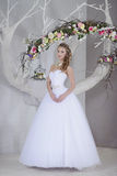 Beauty bride in bridal gown indoors Royalty Free Stock Photography