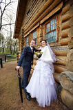Beauty bride and elegant groom near old wood house Royalty Free Stock Photography