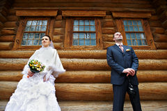 Beauty bride and elegant groom near old wood house Royalty Free Stock Photos
