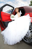 Beauty bride with limousine Stock Photography