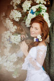 Beauty bride in a luxurious interior with flowers Stock Photos