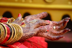 Beauty of the Bride. Marriages are colorful when it is India. The beautiful designs in the hand is the artistic work called Mehandi design. This work is more Royalty Free Stock Photography