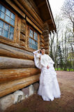 Beauty bride near old wood house Royalty Free Stock Image