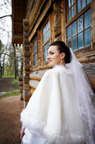 Beauty bride near wood house Stock Photos