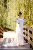 Beauty bride wearing fashion wedding dress with luxury make-up and hairstyle stock image