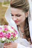 Beauty bride with wedding bouquet Royalty Free Stock Photo