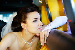 Beauty bride in wedding limousine Stock Image
