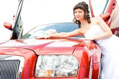 Beauty bride woman with limousine Stock Image