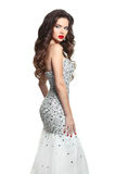 Beauty Bride woman in wedding dress. Long hair, makeup. Brunette. Posing in Shiny Beaded Sequins Mermaid formal party gown isolated on white background Royalty Free Stock Image
