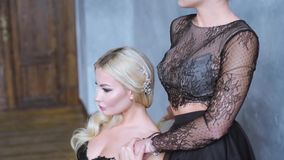 Beauty brides in bridal gown with lace veil indoors stock video footage