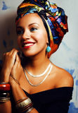 Beauty bright african woman with creative make up, shawl on head like cubian Royalty Free Stock Images