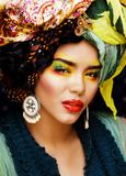 Beauty bright woman with creative make up, many shawls on head l Stock Photos