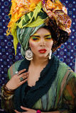 Beauty bright woman with creative make up, many shawls on head Royalty Free Stock Image