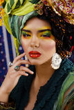 Beauty bright woman with creative make up, many shawls on head Royalty Free Stock Images