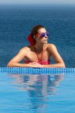 Beauty Bronzed. Poolside Girl. Woman in Red Royalty Free Stock Image