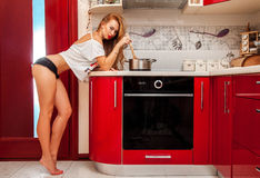 Beauty brown hair woman in panties on kitchen Royalty Free Stock Image